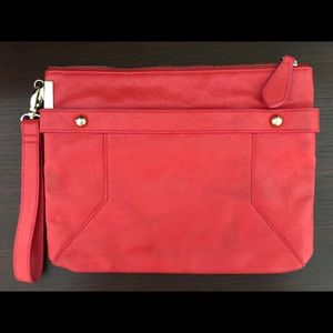 Happy, bright coral clutch from The Limited